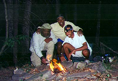 Heru, Bryon and Quinn at campfire